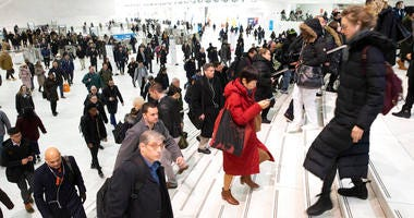 In this Dec. 4, 2019, file photo commuters pass through the World Trade Center in New York. A study by a U.S. agency has found that facial recognition technology often performs unevenly based on a person's race, gender or age.