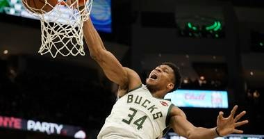 Milwaukee Bucks' Giannis Antetokounmpo dunks during the second half of an NBA basketball game against the Indiana Pacers Sunday, Dec. 22, 2019, in Milwaukee. The Bucks won 117-89.