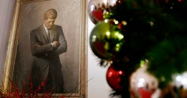 a portrait of former President John F. Kennedy, framed by Christmas decorations, hangs in the White House in Washington.