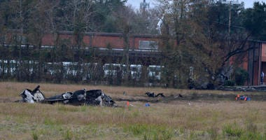 A view of the burnt wreckage of a plane crash near Feu Follet Road and Verot School Road in Lafayette, La., Saturday.