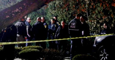 Police gather outside a residence in Monsey, N.Y., early Sunday, following a stabbing Saturday during a Hanukkah celebration.