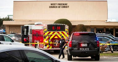 Police and fire departments surround the scene of a shooting at West Freeway Church of Christ in White Settlement, Texas.