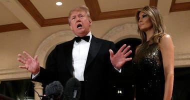 President Donald Trump speaks to the media about the situation at the U.S. embassy in Baghdad, from his Mar-a-Lago property, Tuesday, Dec. 31, 2019, in Palm Beach, Fla., as Melania Trump stands next to him.