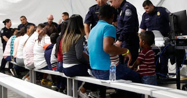 Migrants who are applying for asylum in the United States go through a processing area at a new tent courtroom at the Migration Protection Protocols Immigration Hearing Facility, in Laredo, Texas.