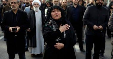 A woman mournsIranian Revolutionary Guard Gen. Qassem Soleimani.