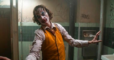 "This image released by Warner Bros. Pictures shows Joaquin Phoenix in a scene from ""Joker."""
