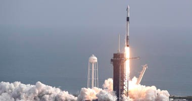 A Falcon 9 SpaceX rocket lifts off from pad 39A during a test flight to demonstrate the capsule's emergency escape system at the Kennedy Space Center in Cape Canaveral, Fla., Sunday.