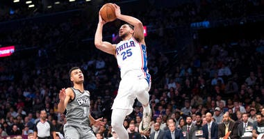 Philadelphia 76ers guard Ben Simmons (25) goes to the basket past Brooklyn Nets guard Chris Chiozza (9) during the first half of an NBA basketball game, Monday, Jan. 20, 2020, in New York.