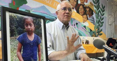 Annunciation House director Ruben Garcia answers questions from the media after reading a statement from the family of Jakelin Caal Maquin, pictured at left, during a press briefing at Casa Vides, Saturday, Dec. 15, 2018, in downtown El Paso, Texas.