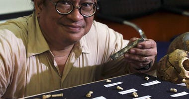 Filipino archeologist Armand Salvador Mijares shows bones and teeth they recovered from Callao Cave belonging to a new specie they called Homo luzonensis during a press conference in metropolitan Manila, Philippines on Thursday, April 11, 2019.