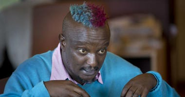 In this Wednesday, Jan. 22, 2014 file photo, prize-winning Kenyan author Binyavanga Wainaina talks during a television interview in Nairobi, Kenya.