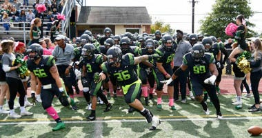 Delaware Valley University football team running out to the field.