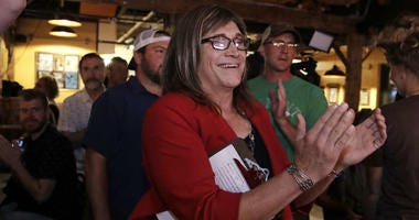 Vermont Democratic gubernatorial candidate Christine Hallquist, a transgender woman and former electric company executive, applauds with her supporters during her election night party in Burlington, Vt., Tuesday, Aug. 14, 2018.