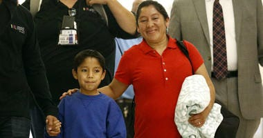Darwin Micheal Mejia, left, and his mother Beata Mariana de Jesus Mejia-Mejia are escorted to a news conference after their reunion at Baltimore-Washington International Thurgood Marshall Airport, Friday, June 22, 2018, in Linthicum, Md.
