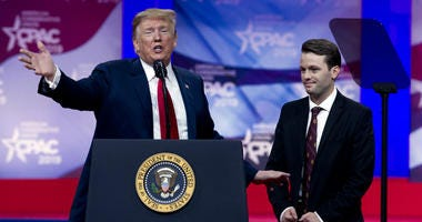 In this March 2, 2019 photo, President Donald Trump invites to the podium, Hayden Williams, a field representative of the Leadership Institute, who was assaulted at Berkeley campus, at the Conservative Political Action Conference, CPAC 2019, in Oxon Hill,
