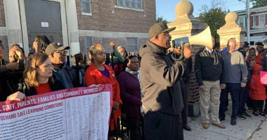 Activist Antoine Little leads a rally this morning outside T.M. Pierce Elementary School.