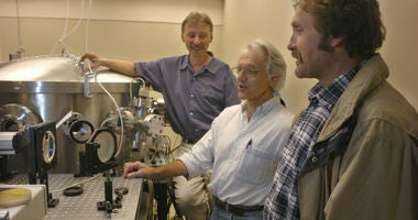 "In this Monday, June 28, 2004 file photo, University of Michigan Professor Gerard Mourou, center, and fellow research scientists talk about the potential of the laser, dubbed ""Hercules,"" that has been built at the University of Michigan lab."