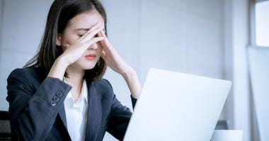 A woman feeling stressed.