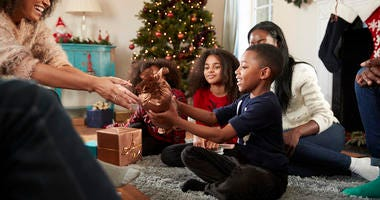 A family giving gifts on Christmas.