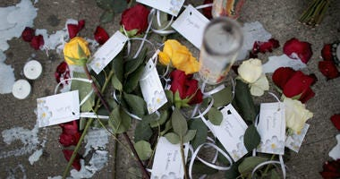 DAYTON, OHIO - AUGUST 06: Flowers bearing the names of those killed in Sunday Morning's mass shooting sits along the sidewalk in the Oregon District on August 06, 2019 in Dayton, Ohio.