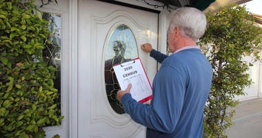 Man going door to door collecting information for the 2020 census.