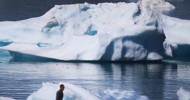 Icebergs seen floating.