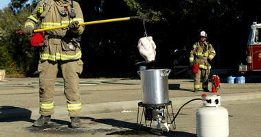 Firefighter demonstrates deep-frying turkey