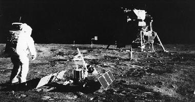 1969: Apollo 11 astronaut Edwin 'Buzz' Aldrin deploys a scientific experiment package on the surface of the moon. In the background is the Lunar Module, as is a flag of the United States.