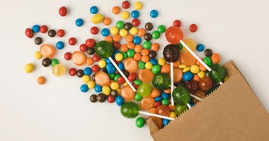 Close-up view of colorful candies in paper bag