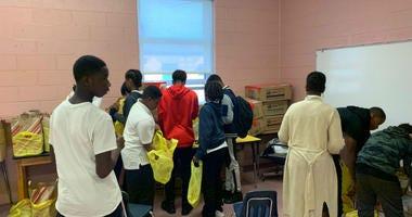 Students volunteering at Penrose Elementary School.