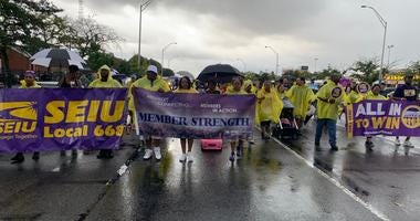 Rain dampens but does not stop the Philadelphia Labor Day parade.