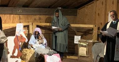 Mary, Joseph, a donkey and more than two dozen carolers took to the streets of Old City Christmas Eve evening, asking neighbors for a place the couple could stay.