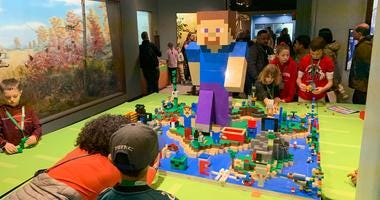A Minefaire display allows Minecraft fans to build by hand.