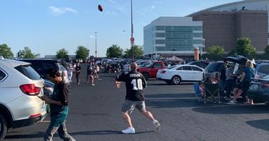 Eagles fans tailgate before the first home preseason game.