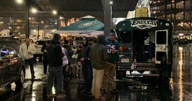Eagles fans face a soggy tailgate before the game against the Giants.