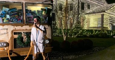 """Steve Harbaugh of Gloucester County has decorated his house to match """"National Lampoon's Christmas Vacation,"""" complete with cousin Eddie and his RV."""