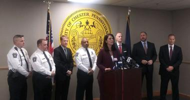 Delaware County District Attorney Katayoun Copeland is joined by U.S. Attorney William M. McSwain, FBI agent Michael Harpster, DEA agent Jonathan Wilson and others in announcing the arrest of 22 rival gang members in Chester, Pa.