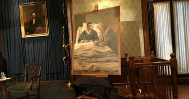 The portrait depicts a unique moment in history: President Ronald Reagan, mortally wounded by a would-be assassin, is allowed visitors, and the first person he receives is Speaker of the House Tip O'Neill.