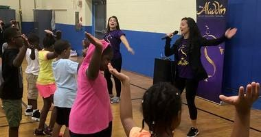 "some of the touring company's actors from ""Aladdin"" stepped off stage to lead a special health and wellness workshop at the Christian Street YMCA for young fans."