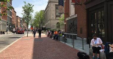 It was a beautiful day to take lunch outdoors, especially in Old City, where a portion of Chestnut Street has finally been reopened following a fire there nearly three months ago.