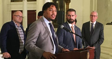 Rep. Malcolm Kenyatta speaks as Rep. Brian Sims (next to him, right) looks on at state Capitol news conference Wednesday.
