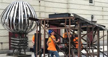 The sphere at the top of the Tower Theater tower was removed around 8 a.m. Tuesday morning.
