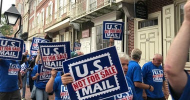 Hundreds of postal workers marched down Market Street.