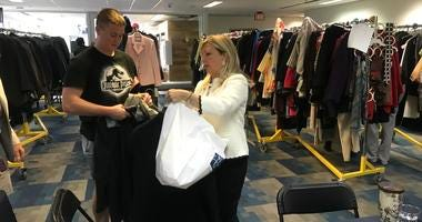 "Danielle McNichol, director of Neumann University's center for leadership, helps outfit young people through the ""Wardrobes for Work"" program."