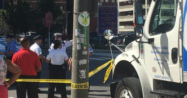 A woman and her baby were struck be a pickup truck while crossing Vine Street at 15th Street.