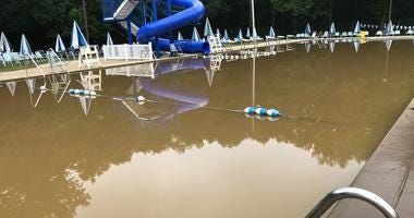 The Springfield Swim Club is a muddy mess this morning. The Darby Creek flooded yesterday and this place was underwater.