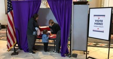 Kids vote for the best of three toys at the Please Touch Museum on Election Day.