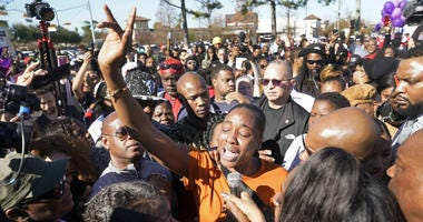 LaPorsha Washington, center, the mother of seven-year-old daughter Jazmine Barnes, who was killed on Sunday, speaks to the crowd during a community rally outside Walmart, Saturday, Jan. 5, 2019, in Houston.