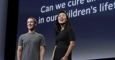 Facebook CEO Mark Zuckerberg and his wife, Priscilla Chan