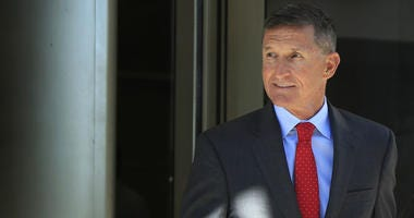 In this Tuesday, July 10, 2018 file photo, former Trump national security adviser Michael Flynn leaves federal courthouse in Washington, following a status hearing.